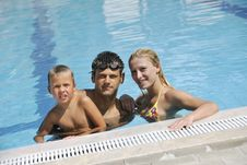 Free Happy Young Family Have Fun On Swimming Pool Stock Photos - 15660233