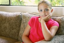 Free Girl Sitting On Couch Stock Images - 15661514