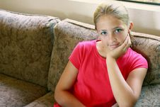 Free Girl Sitting On Couch Royalty Free Stock Photo - 15661515