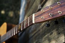 Downward View Of Guitar Fret Board Against A Fence Stock Photography