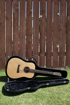 Free Guitar In Case Against A Fence Stock Image - 15661671