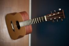 Free Acoustic Guitar Against A Wall Stock Photos - 15661733