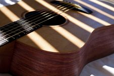 Guitar Detail Under Slatted Light Royalty Free Stock Image