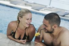 Happy Cople Relaxing  At Swimming Pool Royalty Free Stock Photography