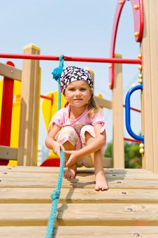 Free Pretty Little Girl On Playground Equipment Royalty Free Stock Images - 15663149