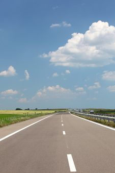 Highway With Blue Sky And Clouds Royalty Free Stock Photos
