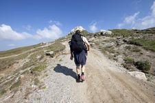 Free Man Trekking In Mountains Royalty Free Stock Photos - 15664448