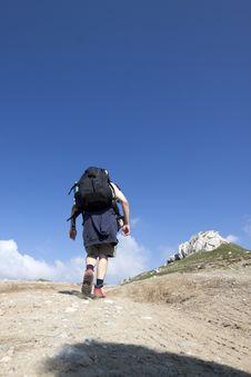 Free Man Trekking In Mountains Royalty Free Stock Images - 15664449