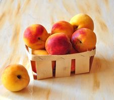 Peaches Are In A Small Basket Royalty Free Stock Photography