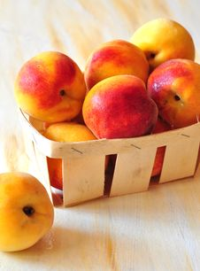 Peaches Are In A Small Basket Stock Photos
