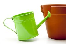 Free Watering Can With Flowerpot Stock Image - 15668611