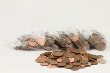 Coins And Bags. Stock Images