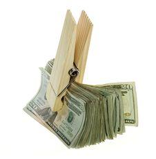 Oversized Paperclip Holding Twenty Dollar Bills Royalty Free Stock Photography
