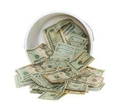 Twenty Dollar Bills Spilling Out Of Bucket Stock Photos