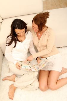 Free Two Girl Friends Reading A Magazin Stock Photos - 15677163