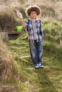 Free Young Boy Carrying Fishing Net At Seaside Royalty Free Stock Images - 15687229