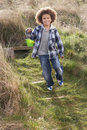 Free Young Boy Carrying Fishing Net At Seaside Royalty Free Stock Image - 15687236