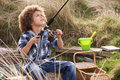 Free Young Boy Fishing At Seaside Royalty Free Stock Photo - 15687315