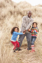 Free Father And Daughters Having Fun In Sand Dunes Stock Photo - 15687900