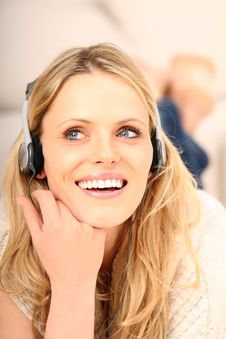 Blond Girl Listening To Music Royalty Free Stock Images