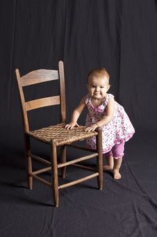 Free Baby Girl And Chair Stock Photography - 15684942