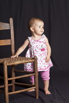 Free Baby Girl And Chair Royalty Free Stock Photography - 15684977