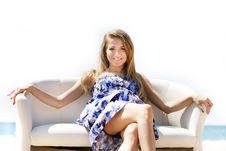 Free Girl Sitting On Beach Sofa Over White Royalty Free Stock Photo - 15686505