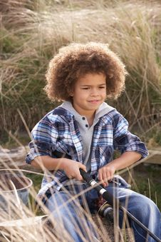 Free Young Boy Fishing At Seaside Stock Photo - 15687310
