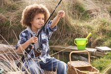 Free Young Boy Fishing At Seaside Stock Images - 15687354