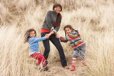 Mother And Daughters Having Fun In Sand Dunes Stock Images