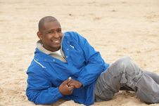 Free Man Relaxing On Beach In Autumn Clothing Stock Image - 15688301