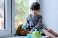 Free Nice Toddler Girl With Toy Tea Set And Bunny Stock Photos - 15689203