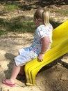 Free GIRL PLAYING ON YELLOW SLIDE Royalty Free Stock Photos - 15694308