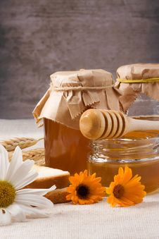 Free Flowers And Honey On Table Stock Photo - 15690280