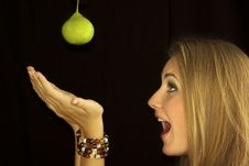 Free Girl And A Green Pear Royalty Free Stock Image - 15690816