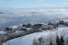 Free Snow On The Houses, Clouds Under Hte Mountain Royalty Free Stock Image - 15691746