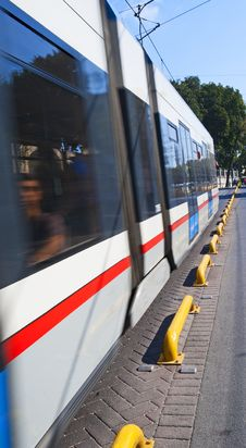 Metro Train Travelling Down A Street Stock Photo
