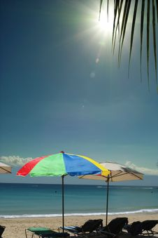 Colorful Umbrellas On Sunny Sea Beach. Royalty Free Stock Images