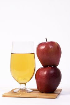 Free Two Apples Stacked Beside A Glass Of Beer Royalty Free Stock Photography - 1576147