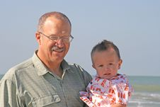 Free Grandfather And Grandson At Beach Stock Photo - 1576870