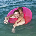 Free Brothers In A Swim Ring Have Fun In The Ocean Royalty Free Stock Photos - 15704308