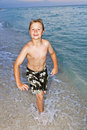 Free Boy Is Jogging At The Beautiful Beach Stock Photography - 15704412