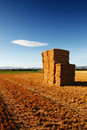 Free Stacks Of Hay Under A Deep Blue Sky Royalty Free Stock Images - 15705109