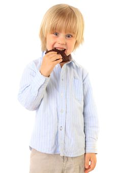 Happy Kid Eating Chocolate Stock Photo