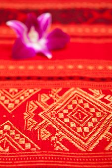 Free Orchid On Native Thai Style Cloth Stock Images - 15701054