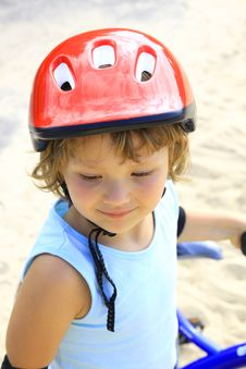 Little Girl In A Red Helmet Royalty Free Stock Images