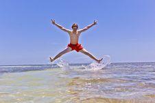 Boy Enjoys The Wonderful Clear Ocean Stock Photography