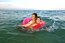 Free Brothers In A Swim Ring Have Fun In The Ocean Royalty Free Stock Photo - 15703625