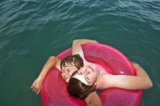 Free Brothers In A Swim Ring Have Fun In The Ocean Stock Photography - 15703742