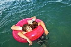 Free Brothers In A Swim Ring Have Fun In The Ocean Royalty Free Stock Photos - 15703798